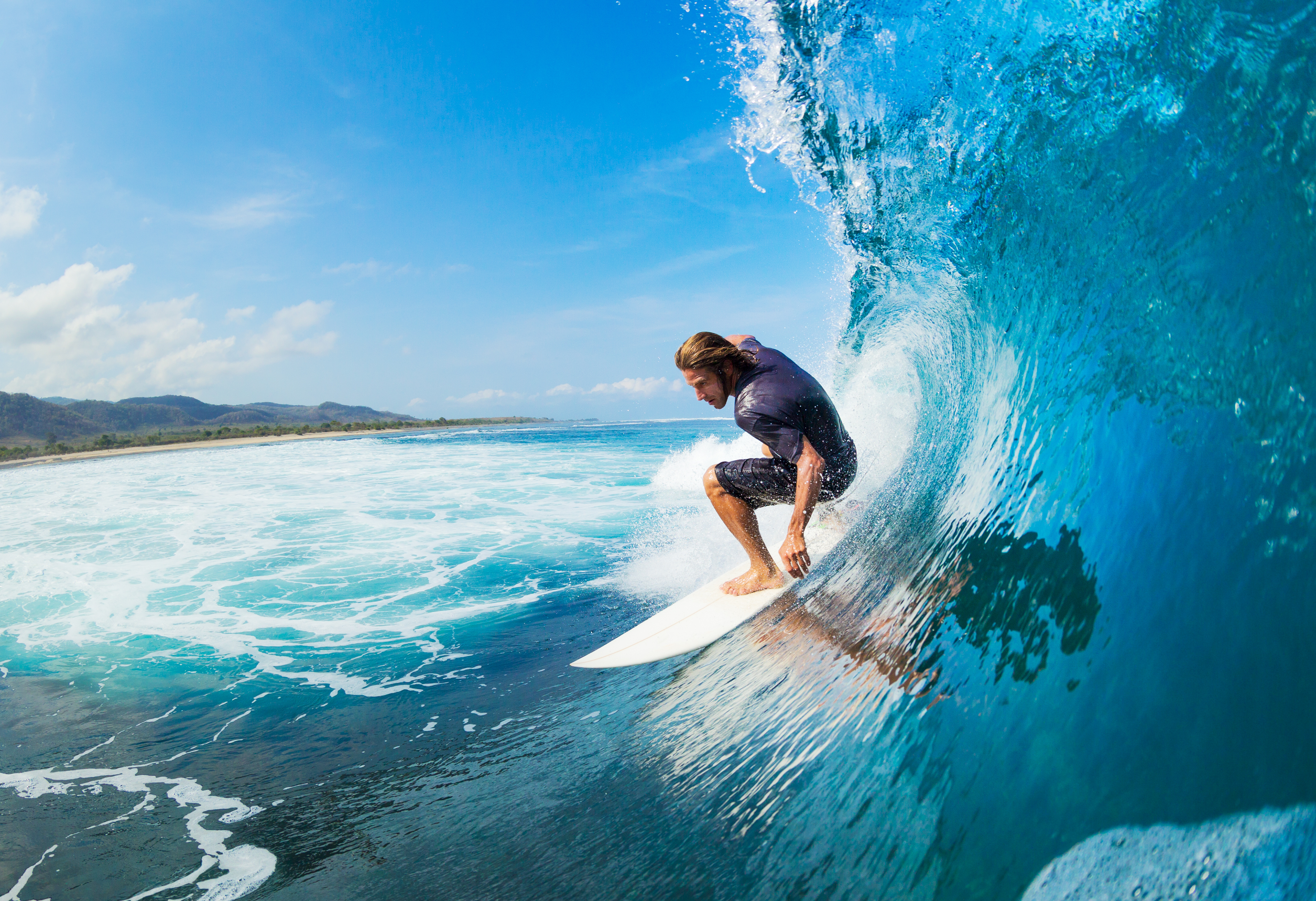Surfing, an excellent full-body workout
